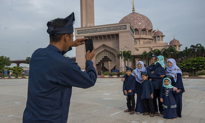 In Putrajaya, folks celebrate Hari Raya in open air while observing social distancing