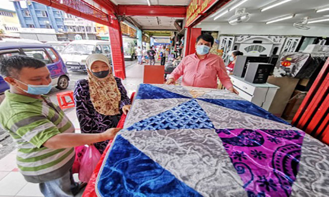 Muslims accept 'new normal' of celebrating Hari Raya
