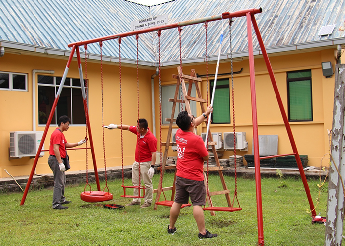 Hotlink team fixing playground swing