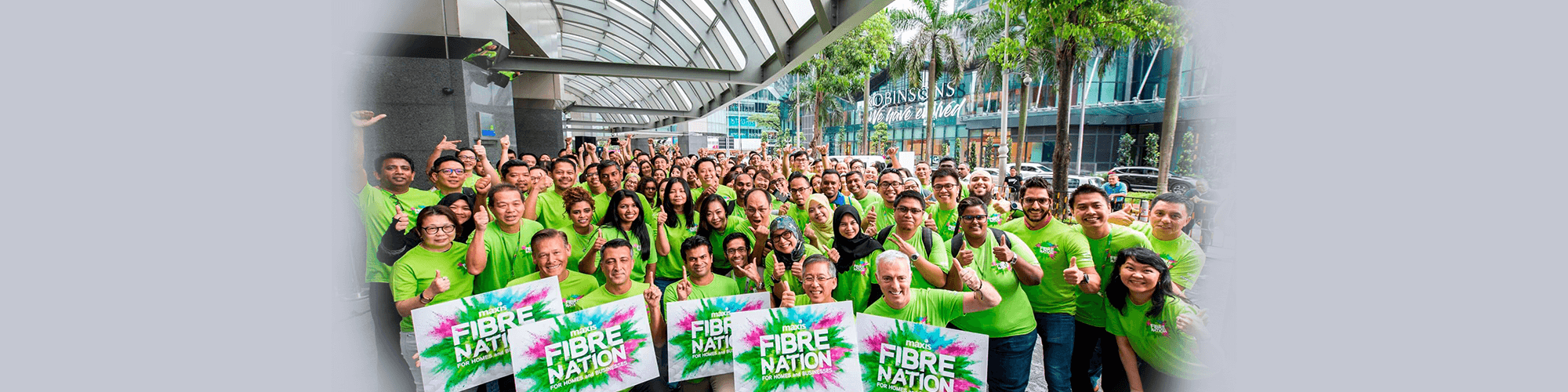 Maxis employees help activate brand new high-speed fibre